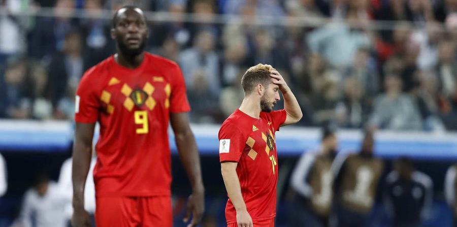 Dries Mertens (derecha) reacciona luego de la derrota en semifinales ante Francia. (AP) (horizontal-x3)