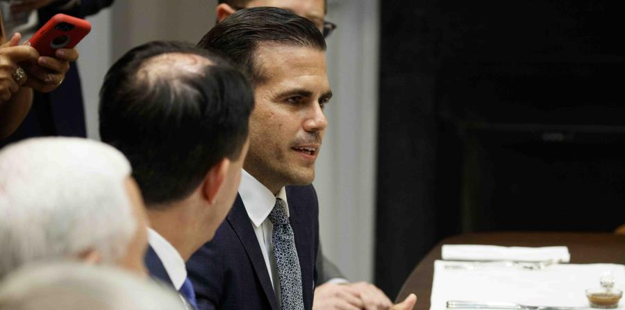 Ricardo Rossello speaks to President Donald Trump during a lunch with governors in the Roosevelt Room of the White House (horizontal-x3)