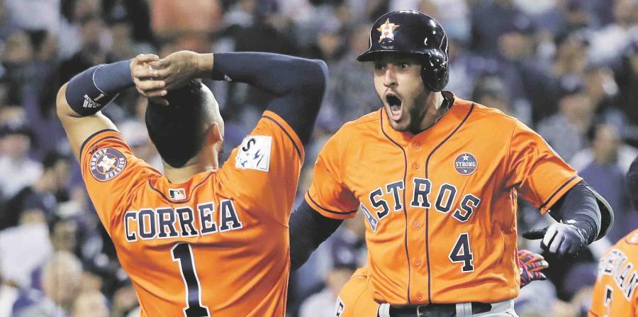 Los peloteros boricuas Carlos Correa y George Springer forman parte del equipo ganador de los Astros de Houston. (horizontal-x3)
