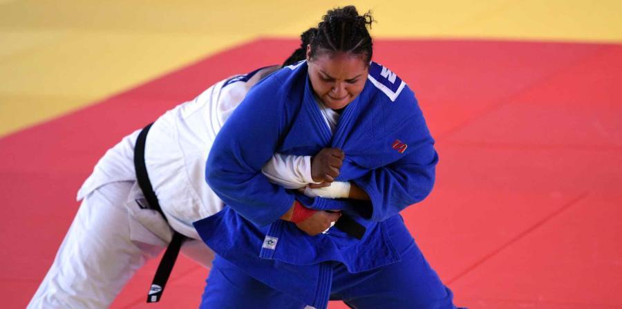 Melissa Mojica (azul) versus Idalys Ortiz de Cuba en Barranquilla 2018. (horizontal-x3)