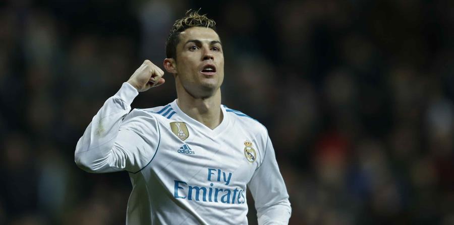 Cristiano Ronaldo celebra luego de anotar un gol contra el Real Sociedad. (AP) (horizontal-x3)
