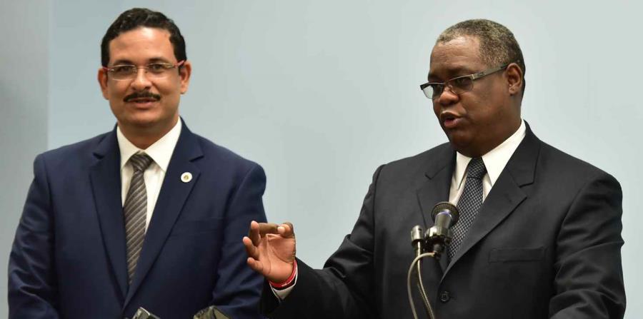 Uroyoán Walker y Carlos Severino, expresidente y exrector, respectivamente, de la Universidad de Puerto Rico. (horizontal-x3)