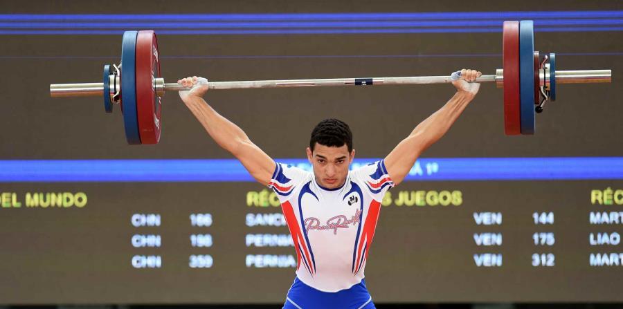 El boricua quedó quinto en arranque con un peso de 124 kg que logró subir en su primer intento. (horizontal-x3)