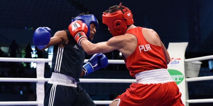 Jan Paul Rivera (rojo) venció por decisión al etíope Endashaw Mekonnen Alayu (azul).  (AIBA) (horizontal-x3)