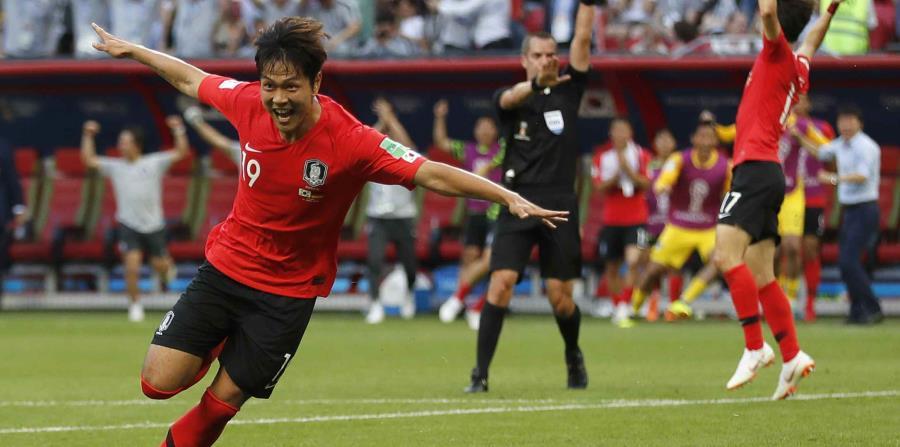 Kim Young-gwon anotó uno de los de Corea del Sur contra Alemania. (AP) (horizontal-x3)