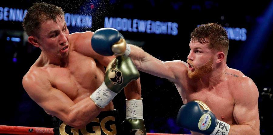 Gennady Golovkin (izq.) (37-0-1 con 33 nocauts) sigue entrenando para pelear el 5 de mayo, fecha festiva para los mexicanos residentes en Estados Unidos. (AP / John Locher) (horizontal-x3)