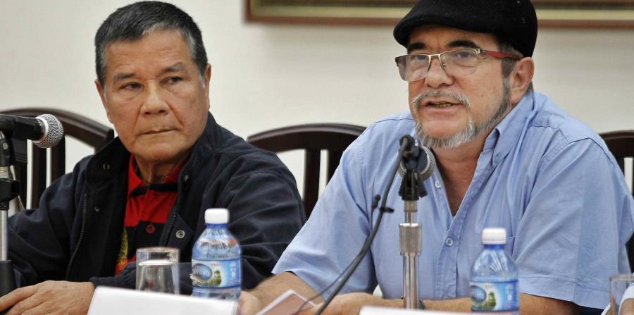 El máximo líder del ELN, Nicolás Rodríguez, alias Gabino, y el comandante de las FARC Rodrigo Londoño, alias ?Timoleón Jiménez?,ofrecen una rueda de prensa conjunta. (horizontal-x3)