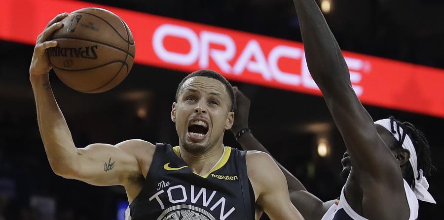 Curry anotó 41 puntos. (AP) (horizontal-x3)