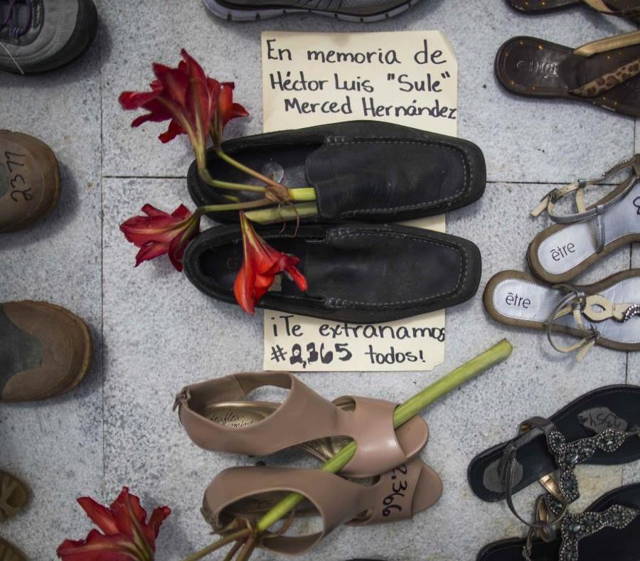 Several shoes were placed at the Capitol in representation of all deaths caused by Hurricane Maria. (semisquare-x3)