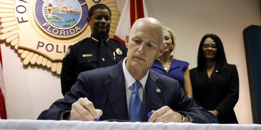 El gobernador de Florida, Rick Scott (horizontal-x3)