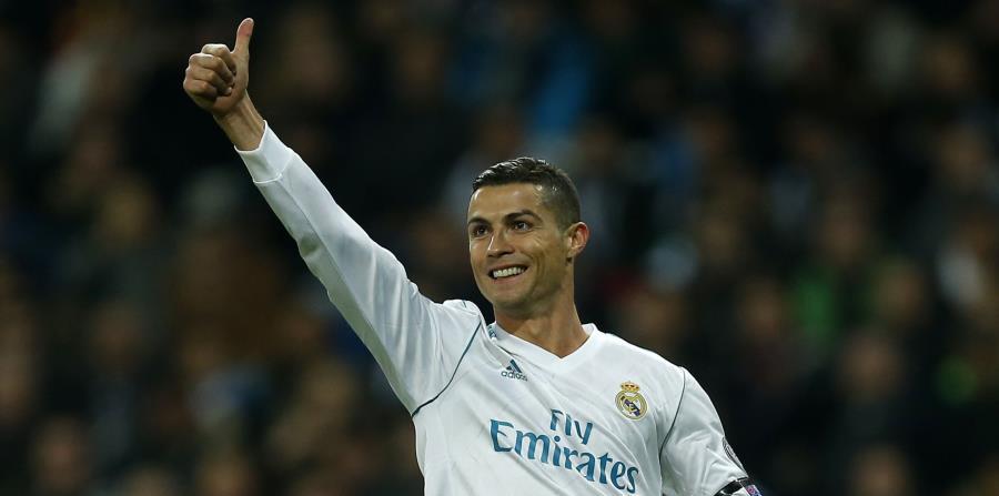 Cristiano Ronaldo superó en la votación a los otros dos finalistas, Messi y Neymar. (AP Photo/Paul White) (horizontal-x3)