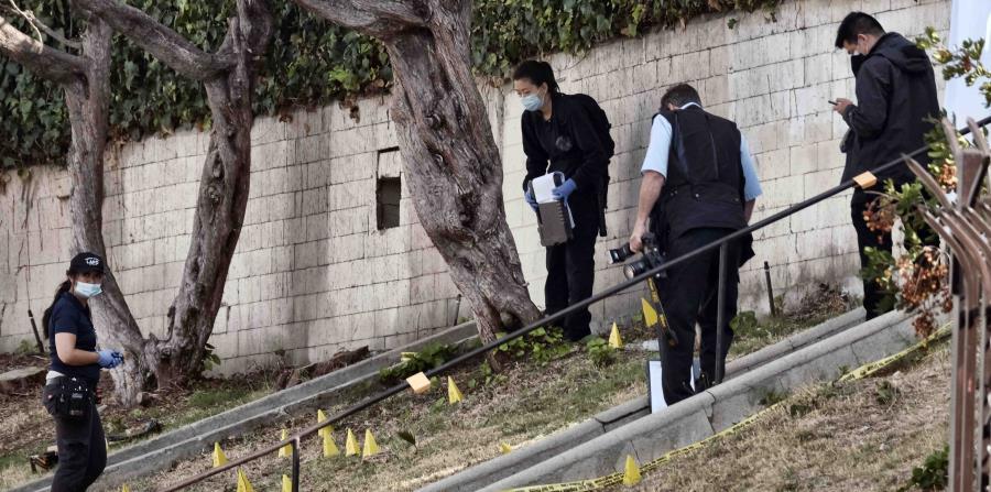 Se prevé que los tres policías heridos por el sospechoso sobrevivirán. (AP / Richard Vogel) (horizontal-x3)