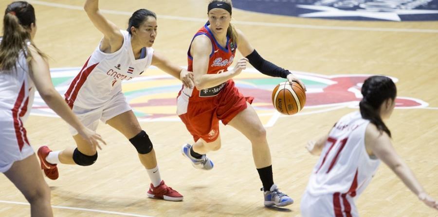 Las boricuas ganaron el primer parcial por 33-0. Con el balón, Allison Gibson. (Suministrada / FIBA) (horizontal-x3)
