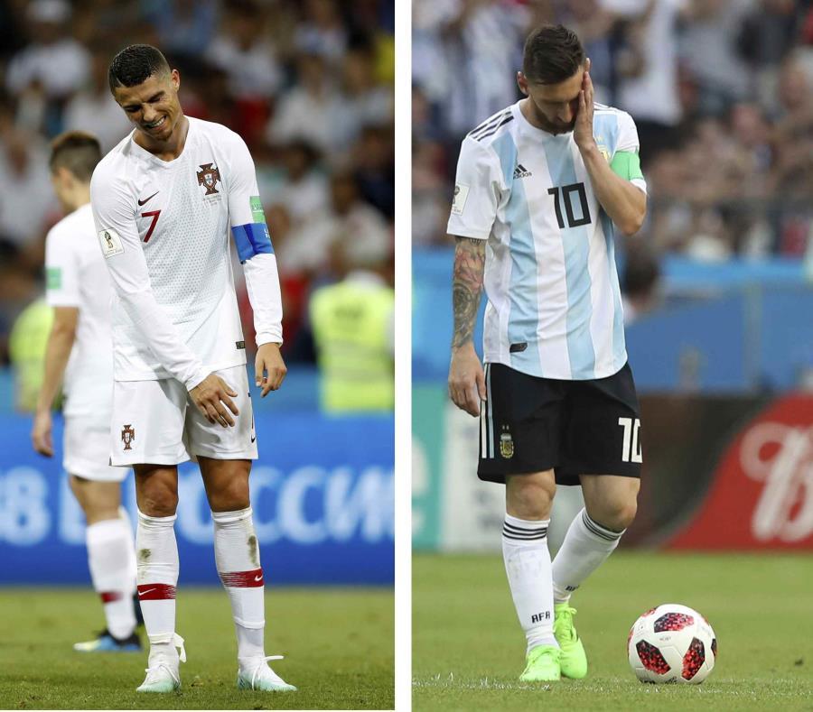Messi (derecha) suma seis goles en 19 partidos de copas mundiales y Cristiano siete en 17. (AP) (semisquare-x3)