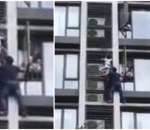 Un padre trepa un edificio para salvar la vida de su hijo