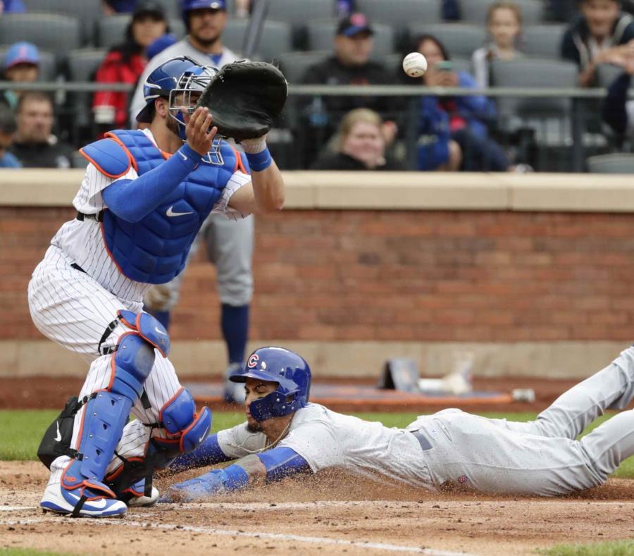 El bayamonés Javier Báez se desliza para completar el robo del home durante el choque contra los Mets de Nueva York. (AP / Frank Franklin II) (semisquare-x3)