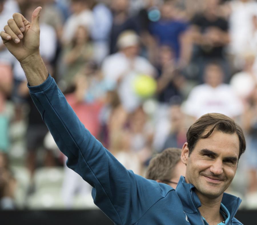 El tenista suizo Roger Federer saborea la victoria. (semisquare-x3)