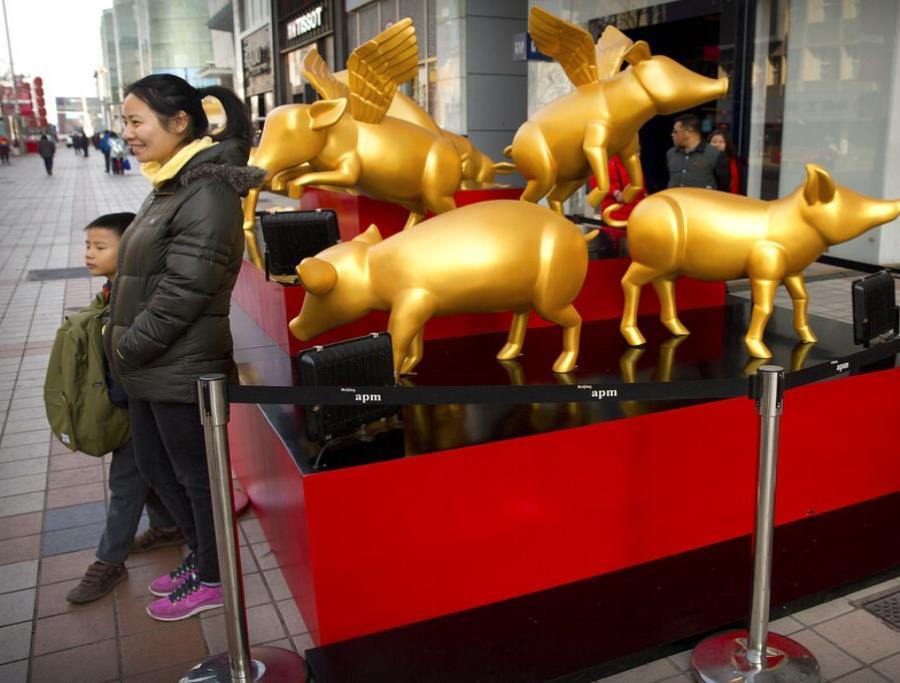 Los chinos asocian al cerdo con la despreocupación, la generosidad, la fertilidad y la abundancia (semisquare-x3)