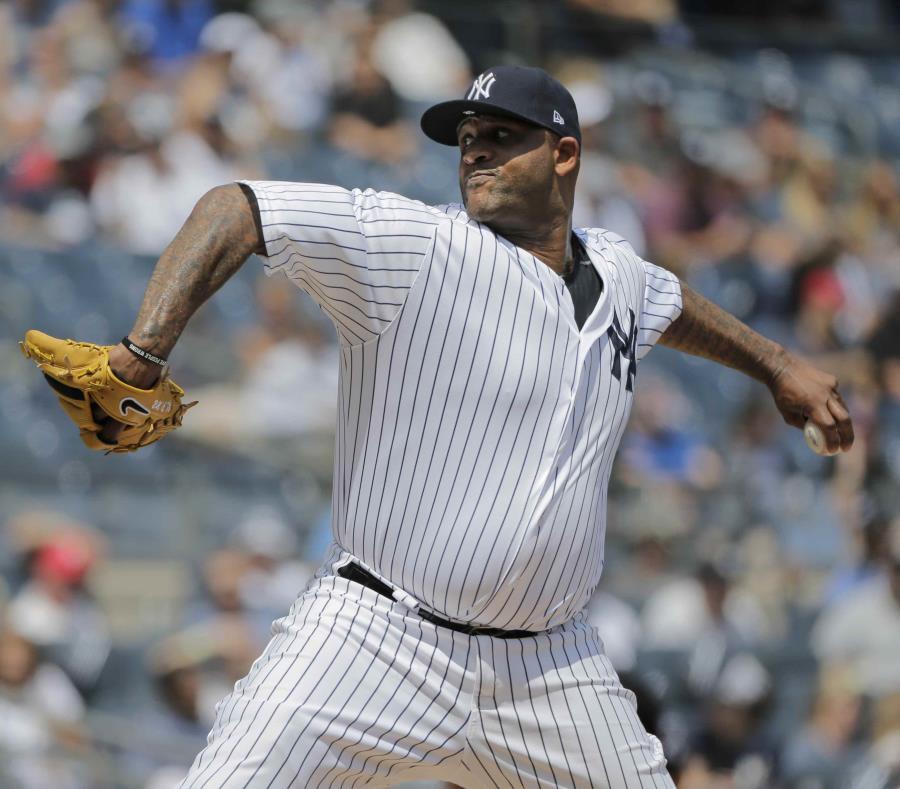 El abridor CC Sabathia lanza por los Yankees de Nueva York en duelo con los Vigilantes de Texas. (AP / Seth Wenig) (semisquare-x3)