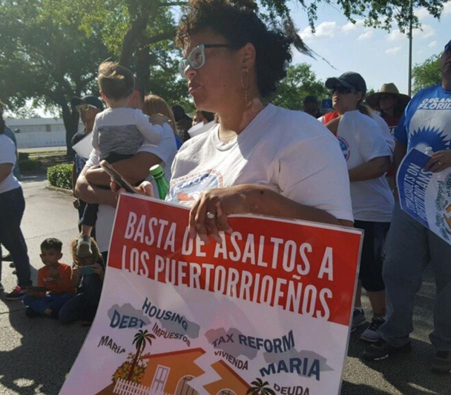 Una integrante de la organización Vamos4PR durante una manifestación en 2018 (semisquare-x3)