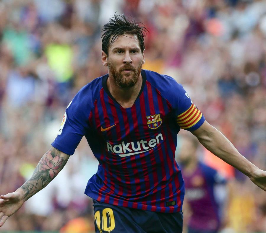 Lionel Messi celebra uno de sus goles en el partido. (AP) (semisquare-x3)
