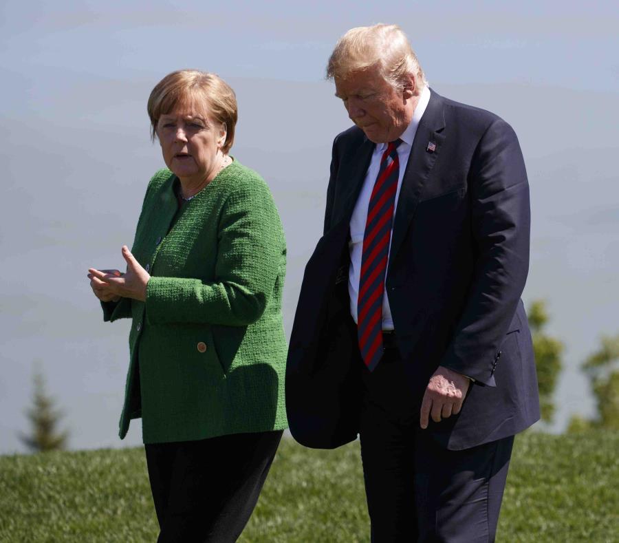 Angela Merkel y Donald Trump. (AP) (semisquare-x3)