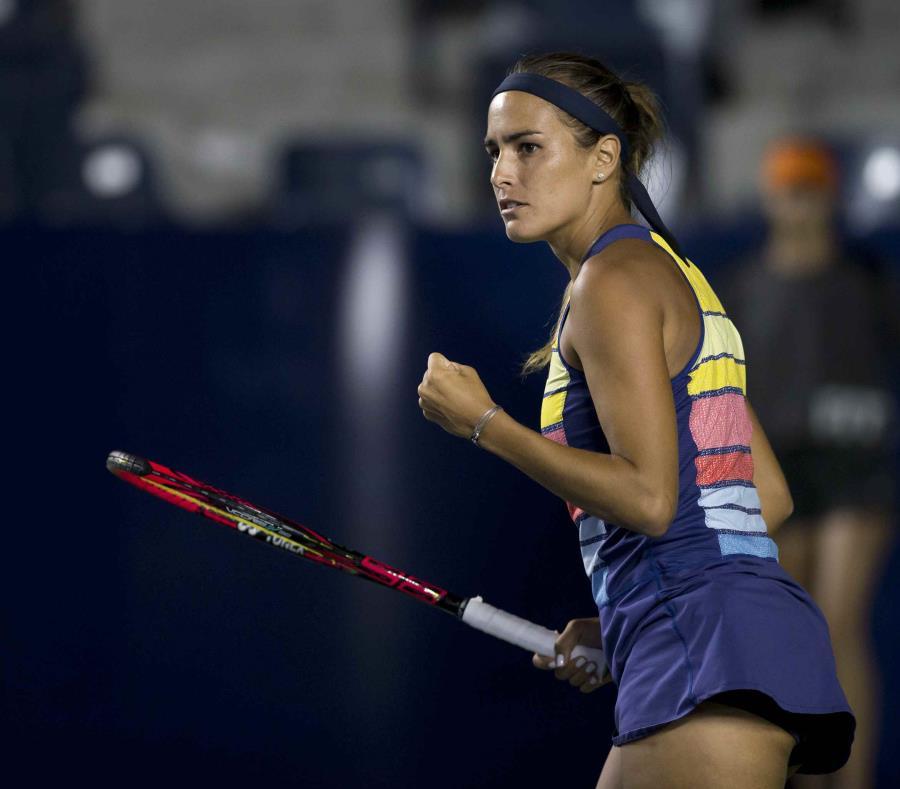 Mónica Puig entró al partido como la número 50 del mundo, tras ver un ascenso de cinco posiciones en la actualización del lunes del escalafón de la Asociación de Tenis Femenino. (EFE / Miguel Sierra) (semisquare-x3)