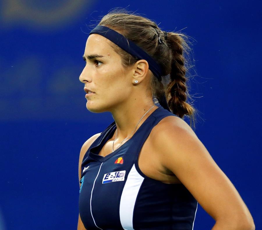 La tenista puertorriqueña Mónica Puig reacciona durante su partido del torneo WTA de Wuhan contra la china Qiang Wang, en Wuhan, China (semisquare-x3)