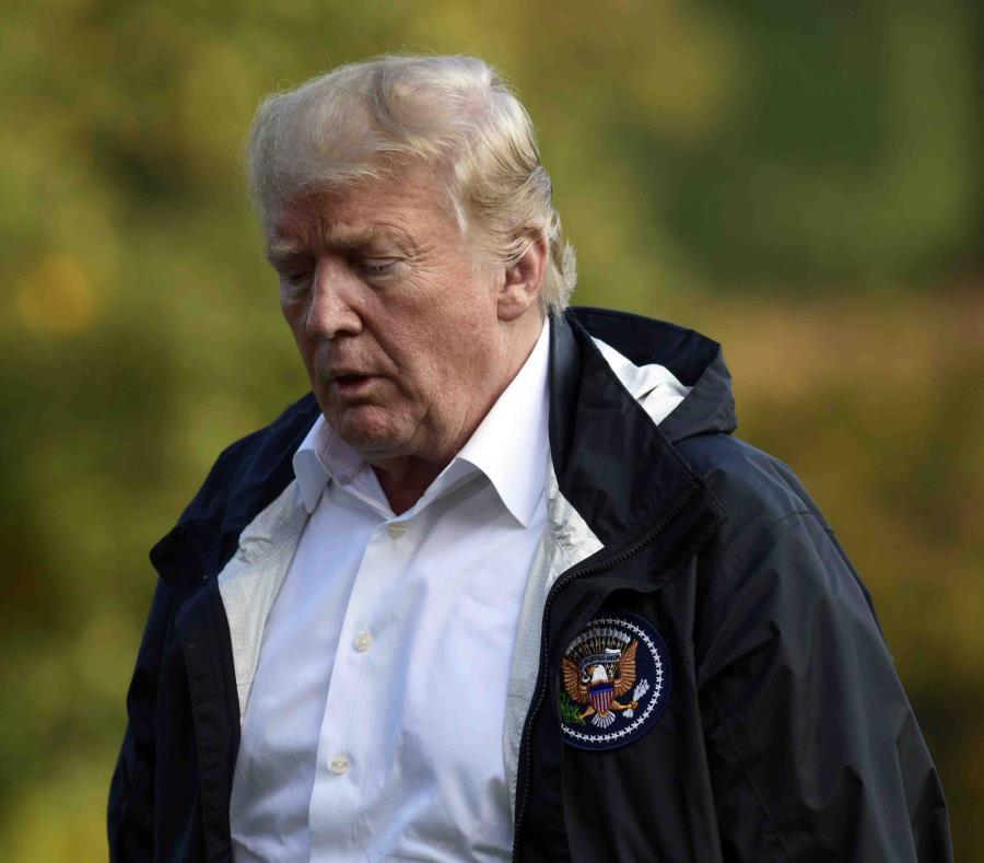 Donald Trump a su llegada a la Casa Blanca tras su viaje a Carolina del Norte y Sur para ver los daños del huracán Florence. (AP) (semisquare-x3)