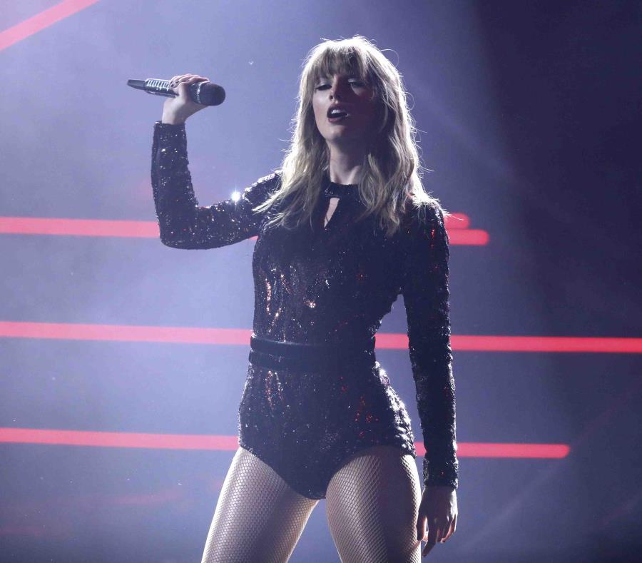Taylor Swift cargó con cuatro premios en los American Music Awards. (Matt Sayles / Invision / AP) (semisquare-x3)