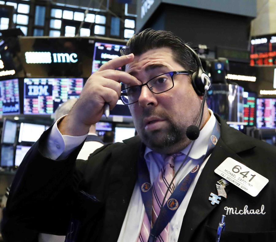 Michael Capolino trabaja en la Bolsa de Valores de Nueva York. (AP) (semisquare-x3)