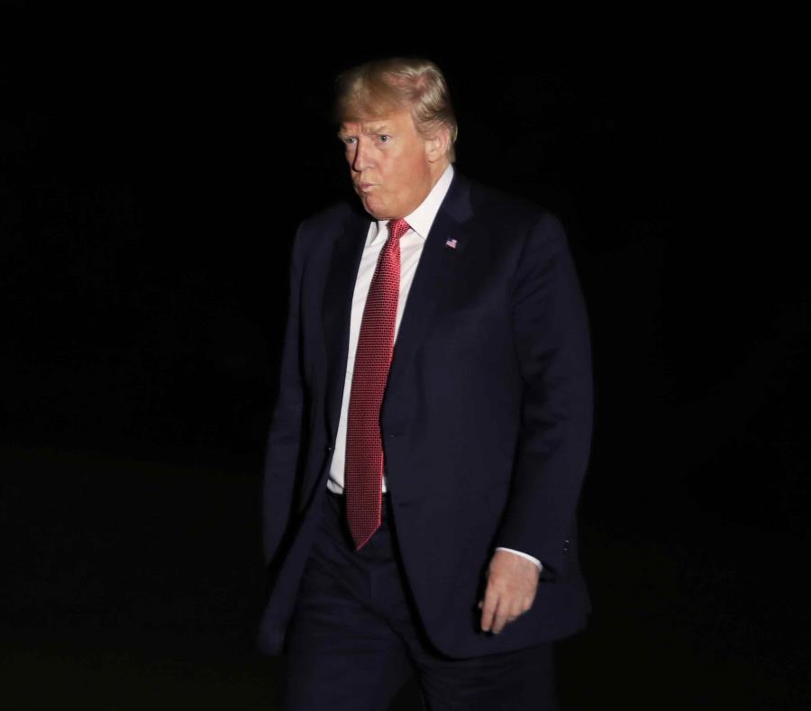 Donald Trump mientras arribaba anoche a la Casa Blanca. (AP) (semisquare-x3)